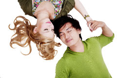 Couple lying on white background Stock Photos