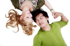 Couple lying on white background Stock Photos