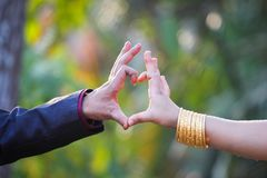 Couple made heart shape with fingers. At outdoors Stock Images