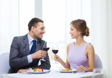 Couple with main course and red wine at restaurant Stock Photos