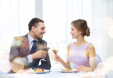 Couple with main course and red wine at restaurant Stock Photo