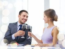 Couple with main course and red wine at restaurant Royalty Free Stock Images