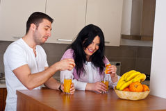 Couple make fresh orange juice Royalty Free Stock Image