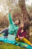 Couple make selfi under the olive tree Stock Photos