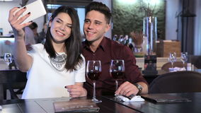 Couple make a selfie at the restaurant stock video footage