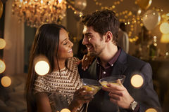 Couple Make Toast At Camera As They Celebrate At Party Stock Photo