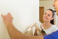 Couple makes repairs at home Royalty Free Stock Image