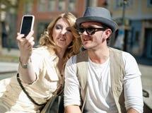 Couple makes self portrait Stock Image