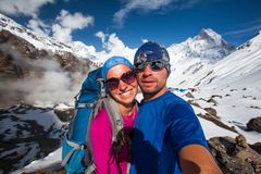 Couple makes selfie in the mountains on the way to Annapurna bas Stock Photos