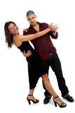 Couple making a. Young woman and man dancing salsa in elegant wear, white background Stock Image