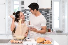 Couple making bakery, cake in kitchen room, Young asian man and woman together royalty free stock images