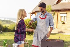 Couple making barbecue stock photography