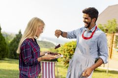 Couple making barbecue royalty free stock photos