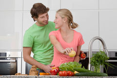 Couple making breakfast Royalty Free Stock Photos