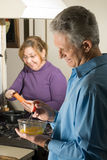 Couple Making Breakfast - vertical Royalty Free Stock Photos