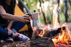 Couple making coffee on the bonfire Royalty Free Stock Photography