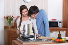 A couple making crepes. Royalty Free Stock Photos
