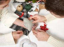 Couple making decorations for Valentine`s day, recover damaged heart, top view - romantic and love concept Stock Photo