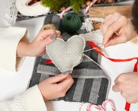 Couple making decorations for Valentine`s day, recover damaged heart, top view - romantic and love concept Royalty Free Stock Photos