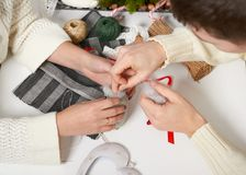 Couple making decorations for Valentine`s day, recover damaged heart, top view - romantic and love concept Stock Images