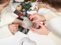 Couple making decorations for Valentine`s day, recover damaged heart, top view - romantic and love concept Royalty Free Stock Images