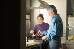 Couple Making Dinner - horizontal Royalty Free Stock Photos