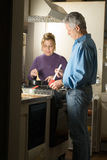 Couple Making Dinner - vertical royalty free stock photography