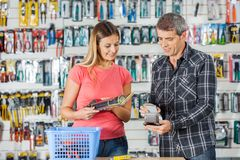 Couple Making Electronic Payment In Hardware Store Stock Photos