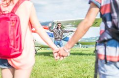 Couple making an excursion on a small airplane. pilot welcomes them Stock Photography
