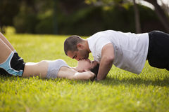 Couple making exercise and kissing Stock Photos