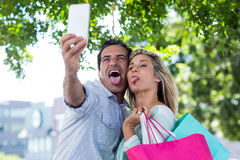 Couple making face while taking selfie Stock Image