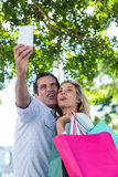 Couple making face while taking selfie in city Royalty Free Stock Photo