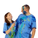 Couple making faces at the camera after a paint wa Stock Photos