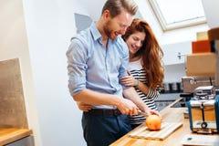 Couple making fresh organic juice Stock Photography