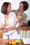 Couple making fruit skewers Royalty Free Stock Images