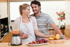 Couple making fruits juice Stock Photo
