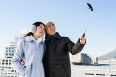 Couple making funny face and clicking pictures Royalty Free Stock Photography