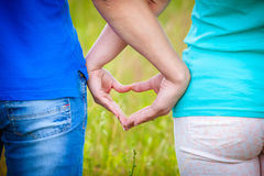 Couple making a heart with hands Royalty Free Stock Photography