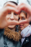 Couple making heart shape with hands Stock Images