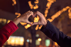 Couple making heart shape with hands Royalty Free Stock Image