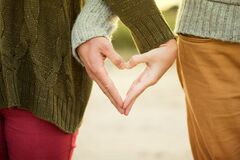 Couple making heart shape with their hands Royalty Free Stock Image