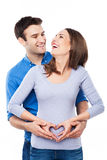 Couple making heart shape on woman belly Stock Images