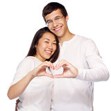 Couple making heart shape Royalty Free Stock Photography