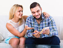 Couple making list of purchases Royalty Free Stock Image