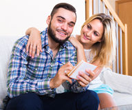 Couple making list of purchases Stock Photography