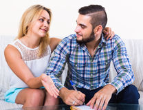 Couple making list of purchases Royalty Free Stock Photography