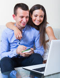 Couple making list for shopping online Stock Images