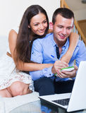 Couple making list for shopping online Royalty Free Stock Photo