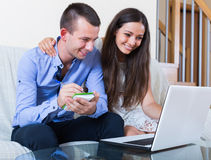Couple making list for shopping online Royalty Free Stock Photography