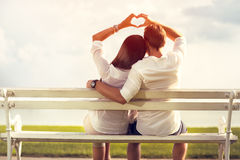 Couple making a love symbol with hands. Affectionate couple making a love symbol with hands royalty free stock image